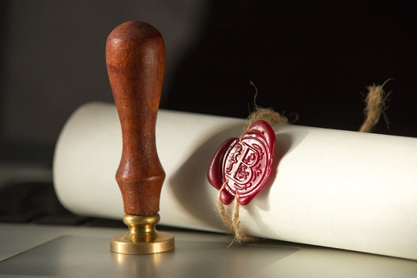 Last will and testament with wooden judge gavel document is
